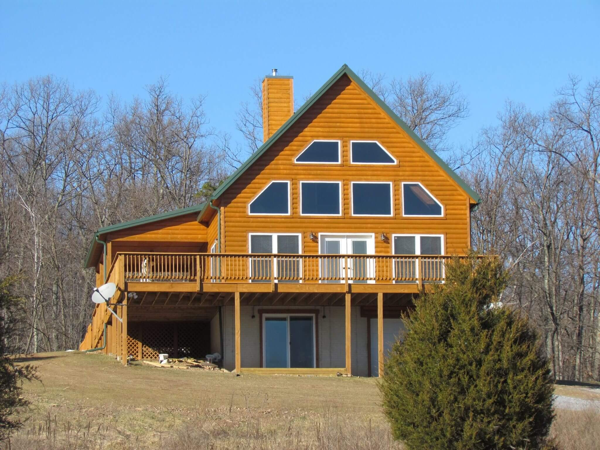 Cedar Siding Custom Home side with deck