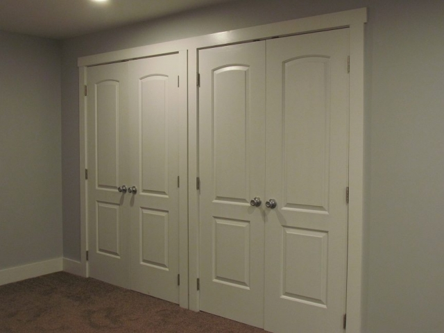 Masculine Transitional Finished Basement closets