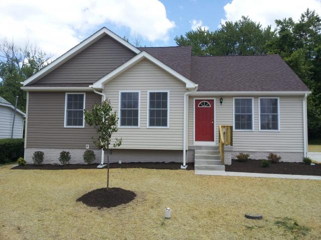 Dove Custom Home front with red door