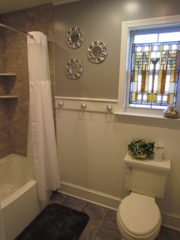Hall Bathroom With A Beachy Feeling stain glass window