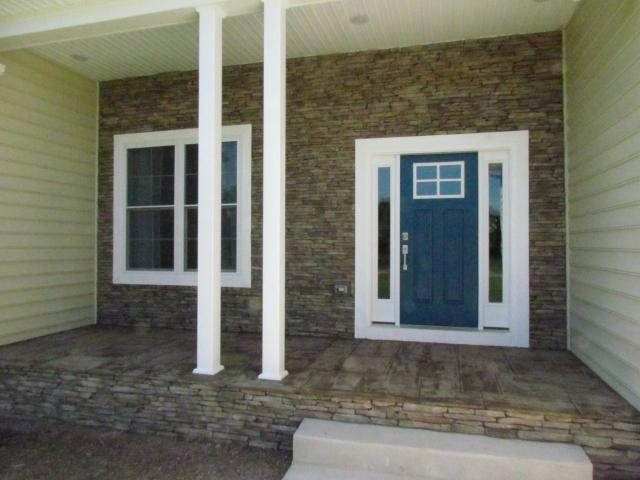 Custom Home With In-Ground Pool front door