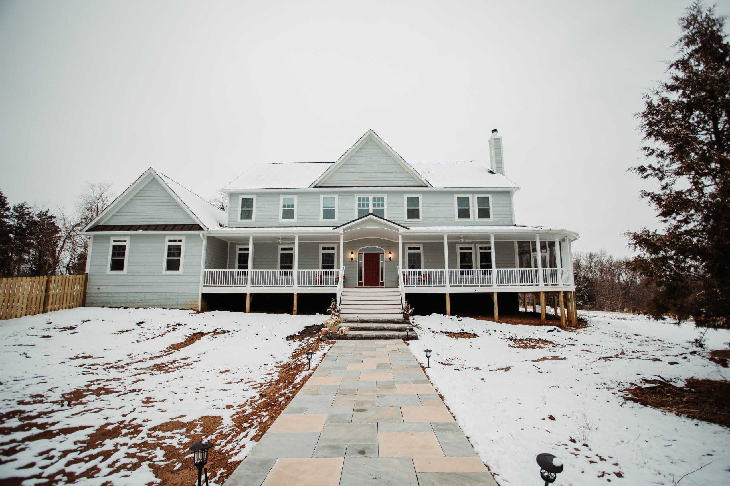 1 custom farm house style snow exterior front wrap around porch stone walk (4)